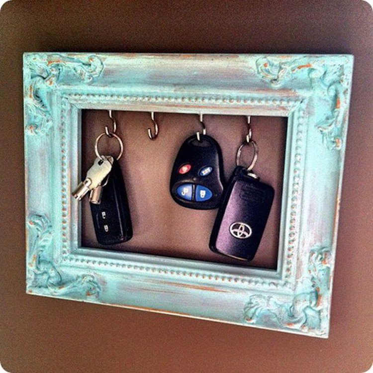 Screw some key hooks into a vintage frame and hang by your door to help keep track of these important items.