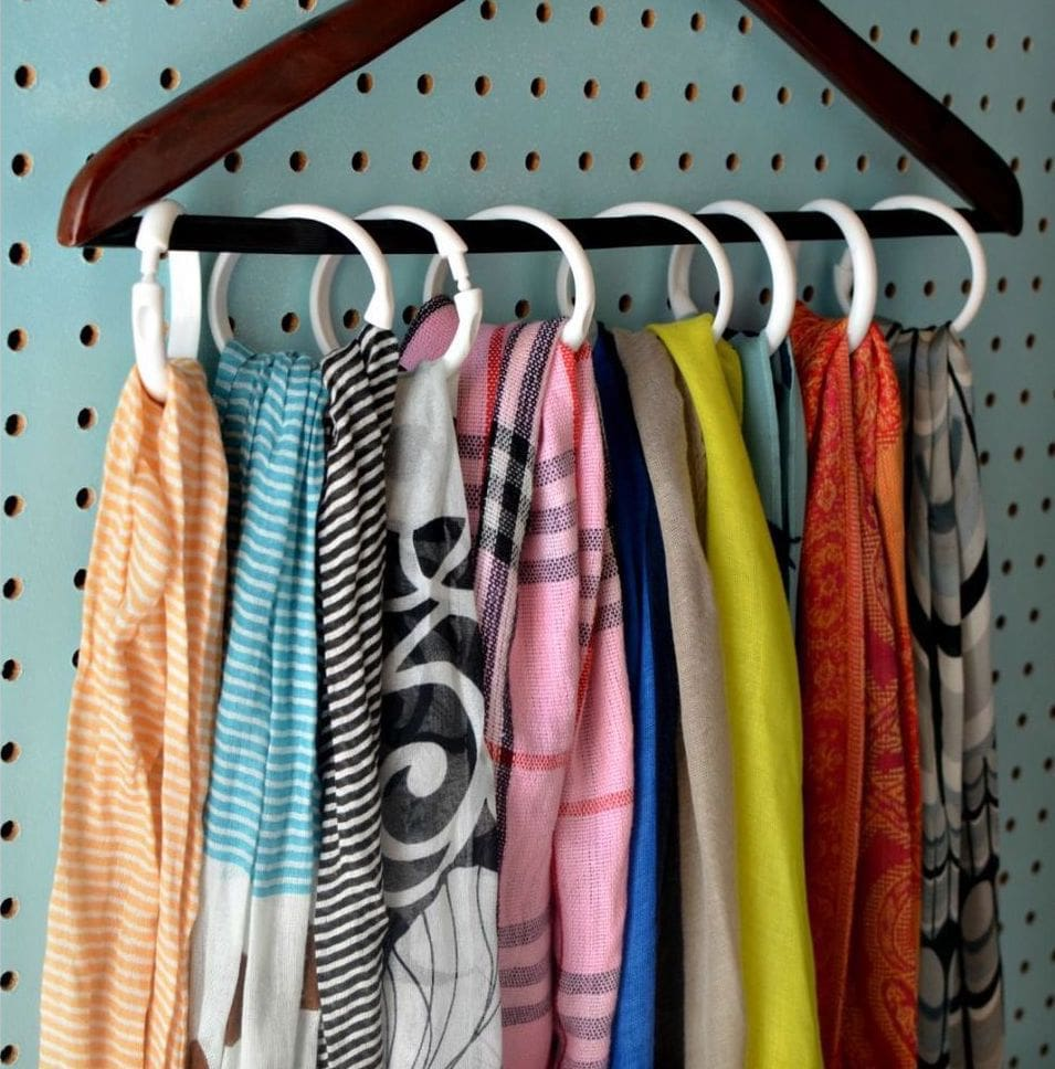 Keep your closet organized with the help of a set of shower hooks and a hanger. Perfect for belts, scarves and a lot of other items that clutter.