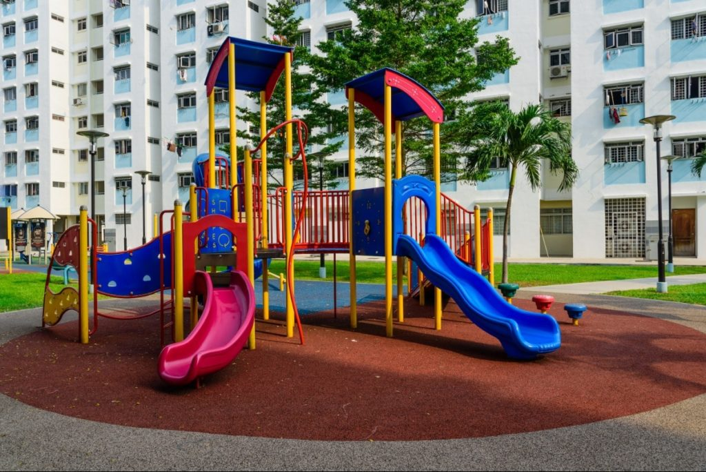Apartment complex caters to children with a playground.
