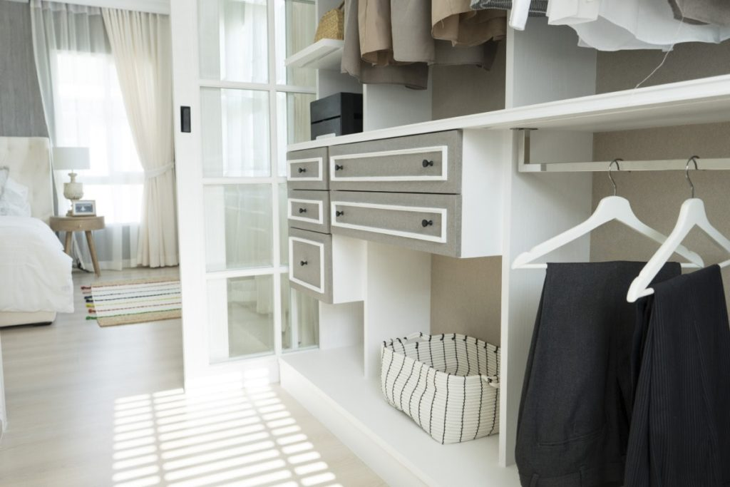 Master bedroom with a spacious walk-in closet.