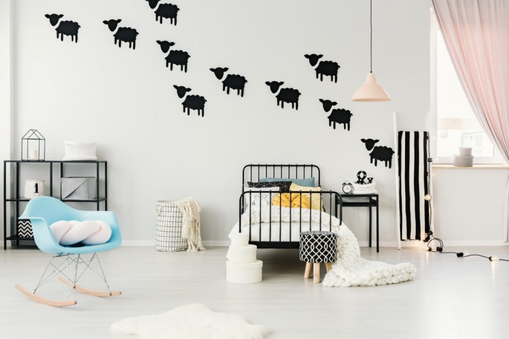 Kids room with black lamb wall decals.