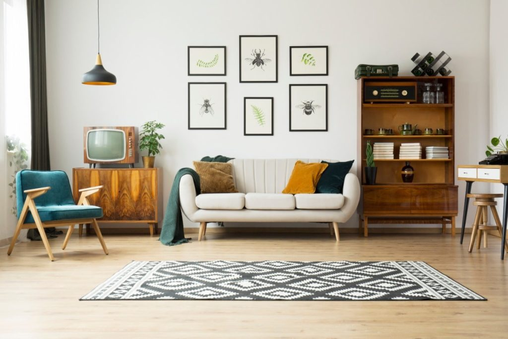 Living room with artwork hanging on wall.