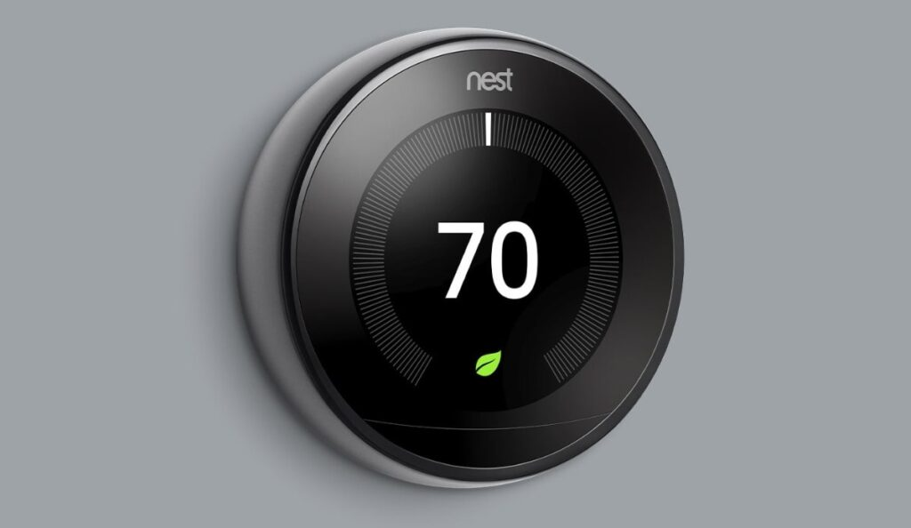 Nest device installed on a plain wall. This is a great landlord thermostat option.