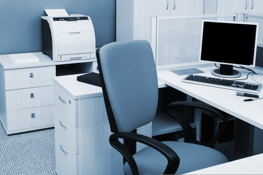 An office chair, desk and printer. All of these are key to creating a home office.