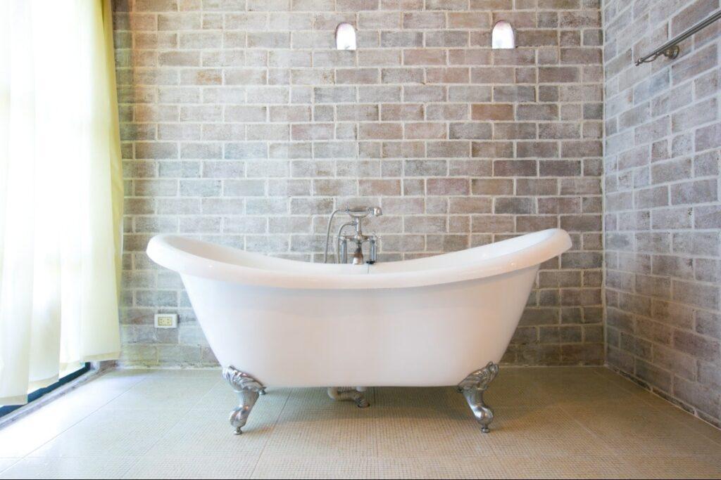 Vintage garden, soaking tub in exposed brick room.