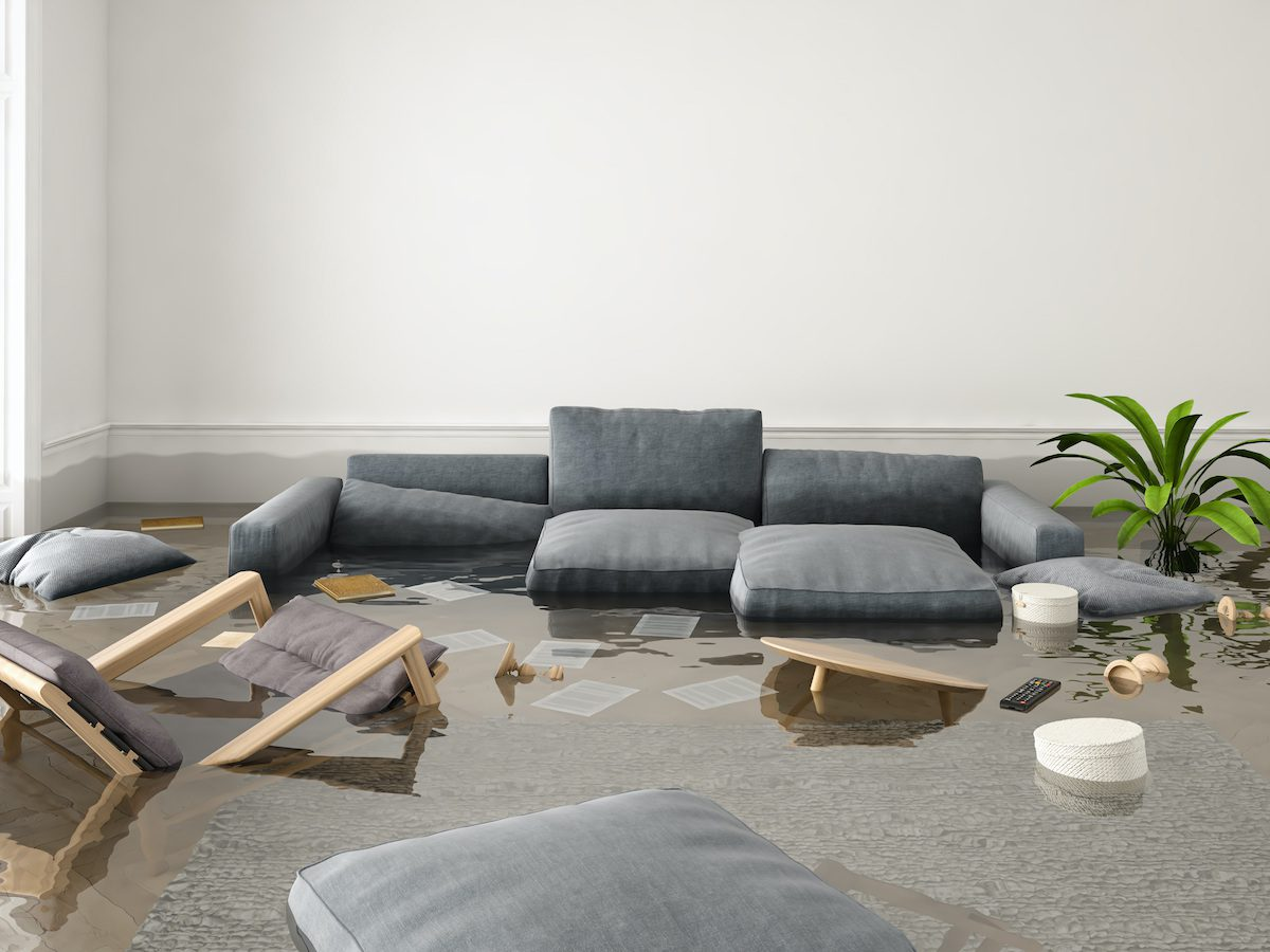 Flooded house with water, the couch and chairs are submerged.