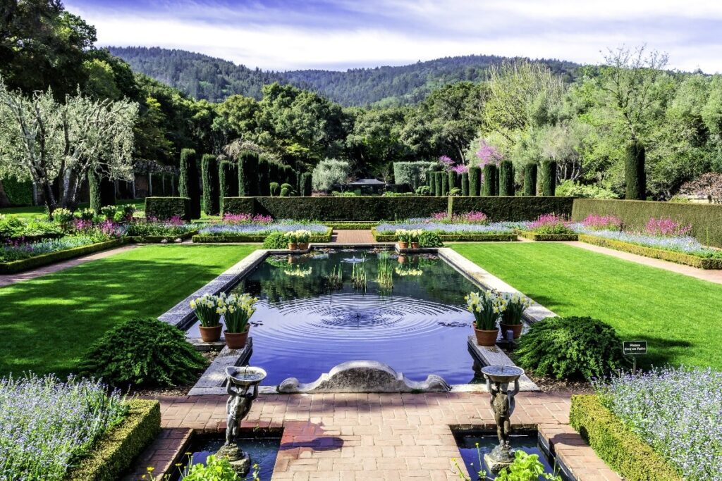 Beautiful symmetrical english style garden with pool
