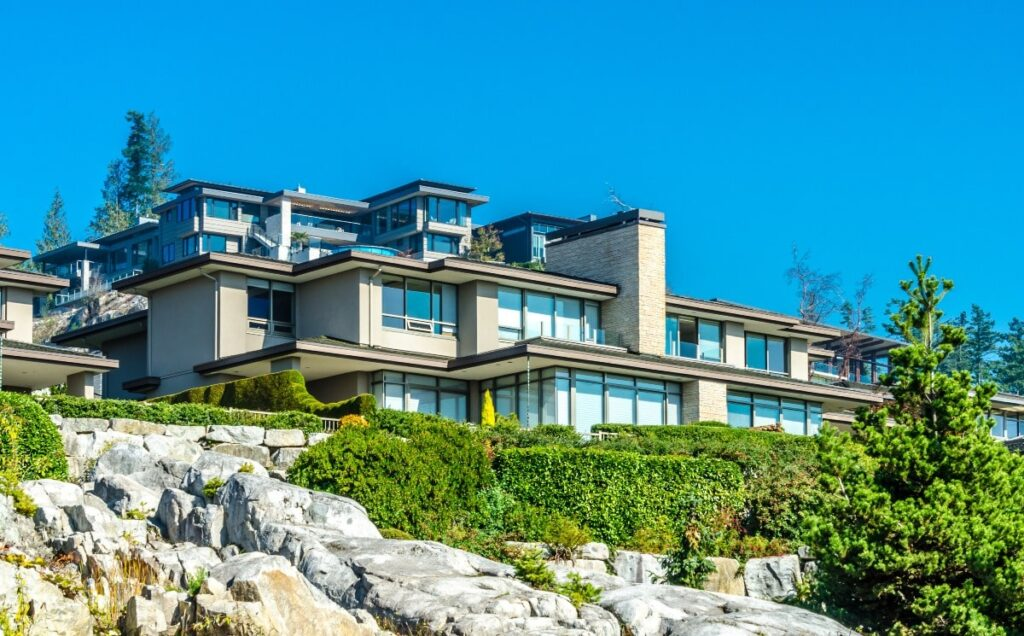 Custom built luxury modern house on a cliff, rock in a residential neighborhood.