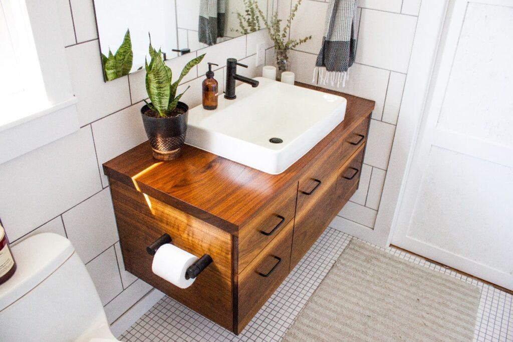 Focused view of wooden vanity in a white bathroom.