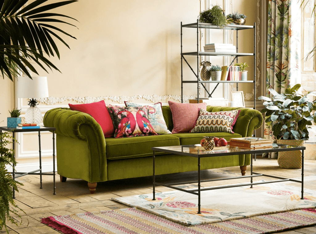 Living room with plants on the floor in various locations, end tables, and shelves,